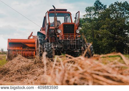 Old Red Tractor In The Field, Ukrainian Fields And Old Machinery, Hay Harvesting In The Field.
