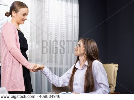 Businesswomen Shaking Hands At Meeting For A Deal. Caring Doctor Supporting Woman During Visit, Hold