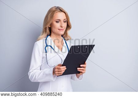 Photo Of Mature Charming Beautiful Medic Woman Reading Information In Check List Isolated On Grey Co