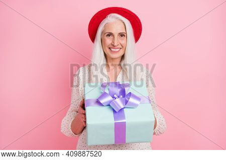 Portrait Of Attractive Charming Cheerful Grey-haired Granny Holding In Hands Giving You Giftbox Isol
