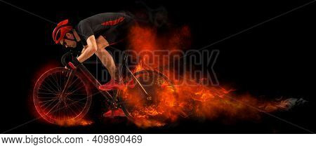 Man extreme biking in motion on fire background. Sports banner. Horizontal copy space background