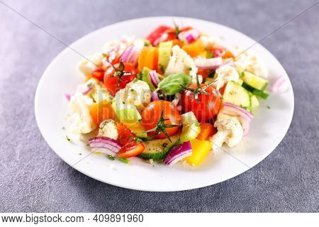 grilled vegetables and herbs in plate