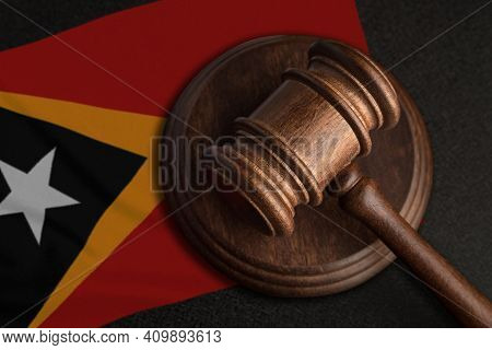 Judge Gavel And Flag Of East Timor. Law And Justice In East Timor. Violation Of Rights And Freedoms.