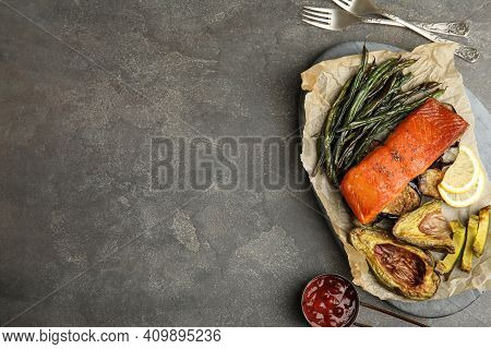 Tasty Cooked Salmon And Vegetables Served On Grey Table, Flat Lay With Space For Text. Healthy Meals