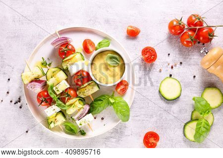 vegetable skewer with courgette,  cherry tomato, onion and cheese feta with dipping sauce
