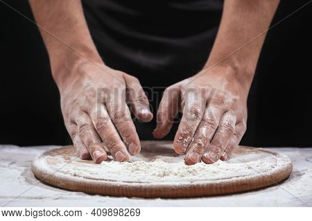 Bakers Hands Kneading Dough In Flour. The Baker Is Preparing, Food Preparation, Close-up.