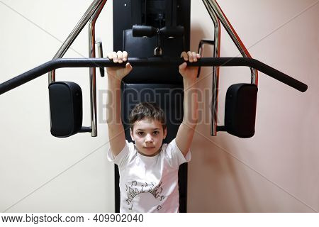 Child Doing Exercises For Back Load On Simulator