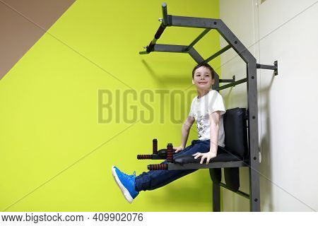 Child Exercising On Uneven Bars