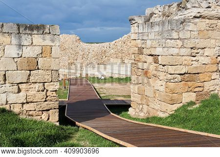 Footbridge For Tourists Among The Ruins Of The Walls Of The Ancient Greek Fortress In Chersonesos
