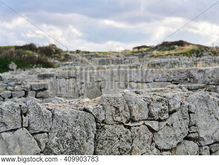 Edge Of Weathered Stone Wall Of Antique Ruins On Blurred Background