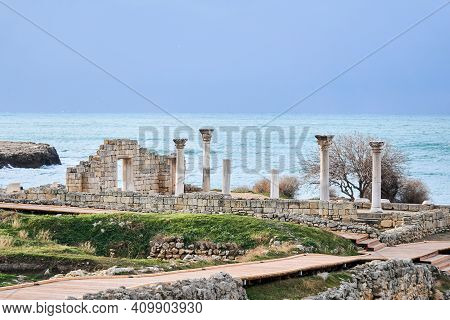 Ruins Of An Ancient Greek Temple With Columns On The Seashore In Chersonesos