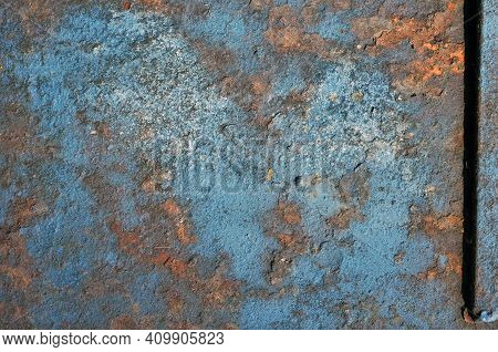 Metal Plate With Weathered Colors And Rust. Close-up Of A Metallic Door Abandoned Outdoors. Natural