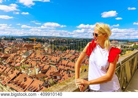 Happy Tourist Girl Looking Bern Old Town, Capital Of Switzerland, From Panoramic Terrace Of Bell Tow