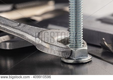 Wrench Tightens Nut In Steel Billet With Ruler And Caliper. Spanner, Bolt, Screw And Nuts.