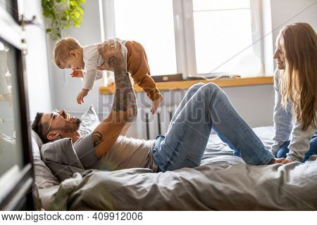 Young family having fun together at home