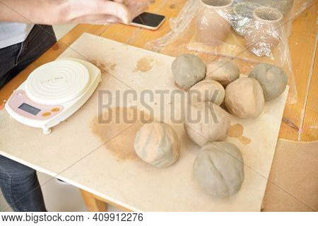 Ceramist With Raw Materials On Table With Sculpting Tools Set Measures Clay For Sculpting In The Pot