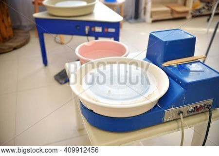 An Empty Blue Potter's Wheel Is Prepared For The Group Practice Of Lepui Pottery From Clay. Tools Fo