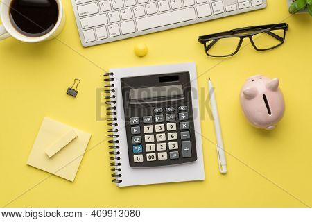 Photo Above Of Calculator Pen Keyboard Cup Of Coffee Glasses Notes Paperclips Moneybox And Notebook