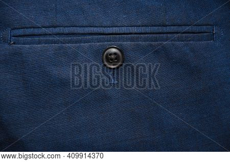 Trouser Pocket With Button, Close Up. Backside View With Buttoned Pocketon The Pants