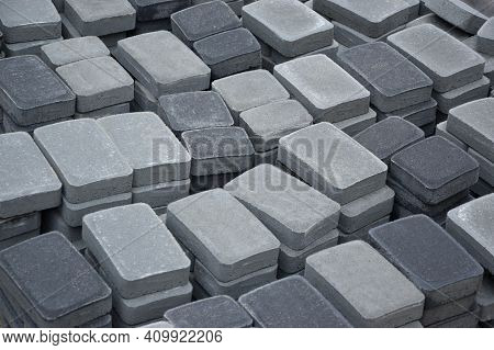 Pile Of Gray And Dark Grey Walkway Slab Lying Down Outdoor. Material For Paving Slabs By Mosaic Clos
