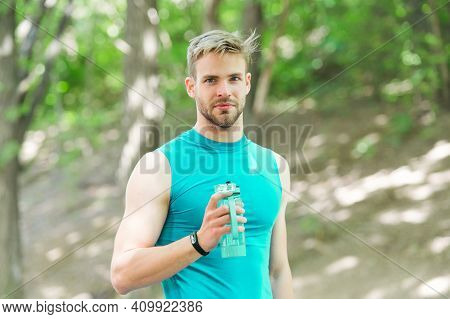 Man Athlete Hold Bottle Care Hydration Body After Workout. Refreshing Vitamin Drink After Great Work