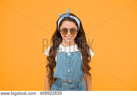 Little Fashionista. Cute Kid Fashion Girl. Summer Fashion Concept. Girl Long Curly Hair Wear Sunglas