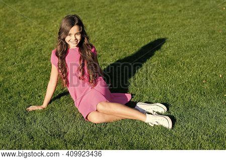 Hello Little Beauty. Little Child Sit On Green Grass. Little Baby Relax Sunny Outdoor. Little Girl I