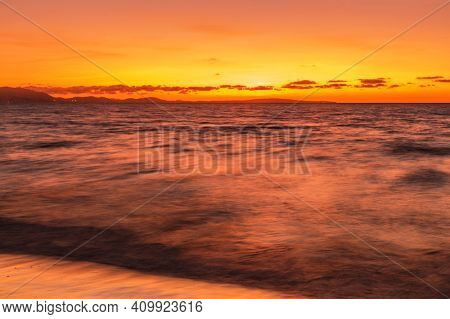 El Arenal beach near Palma de Mallorca in sunset time. Mallorca island, Spain Mediterranean Sea, Balearic Islands.