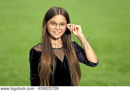 Happy Small Girl With Long Hair In Fashion Black Dress Fix Corrective Glasses With Beauty Look Green