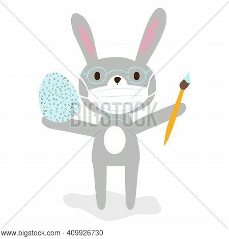Nice Cartoon Grey Rabbit In Glasses With Protective Medical Face Mask Holding A Brush And Easter Egg