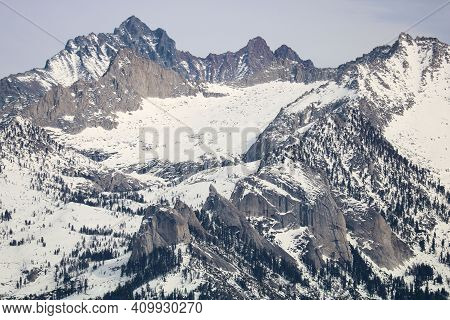 Rugged Snow Covered Peaks With Rocky Crags And Glaciers Taken In The Higher Elevations Of The Sierra
