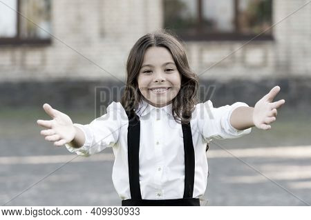Free Hugs. Come Here. Schoolgirl Pull Hands To You. Smiling Schoolgirl Sincere Child Glad To See You