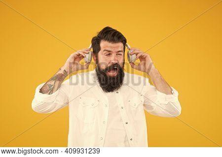 Hearing Problem. Bearded Man Headphones. Active Noise Cancellation Technology. Hipster Listen Music