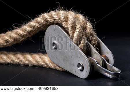 Thick Jute Rope Wrapped On Rollers In A Sailing Pulley. Accessories Used On Yachts For Sailing In Th