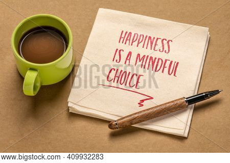 happiness is a mindful choice inspirational note - handwriting on a napkin with a cup of coffee, mindfulness, positivity and personal development concept
