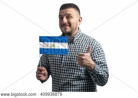 White Guy Holding A Flag Of Nicaragua And Shows The Class By Hand Isolated On A White Background. Li
