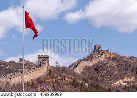 Beijing, China - April 28, 2010: Great Wall Of China. Closeup Of Chinese Red Flag With Meandering Wa
