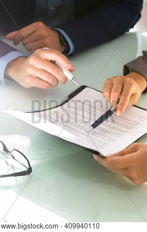 Lawyer Hand Document Review And Contract Mediation