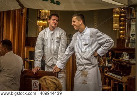 Prague, Czechia - July 2, 2014: Two Waiters, In Traditional Reto Uniform, Waiting For Clients In A C