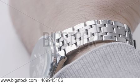 Close Up Of Male Wrist With An Expensive Watch Made Of White Gold. Action. Concept Of A Successful B