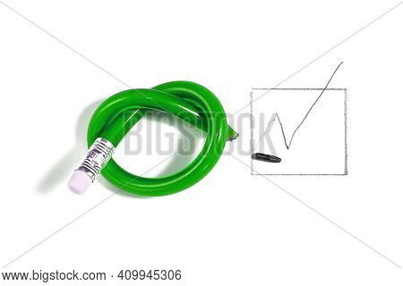 Green Pencil Has Been Knotted During Voting On The Paper. Symbolic Concept Of Disagreeing And Emotio