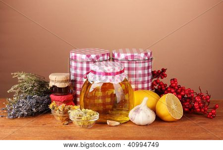 Honey and others natural medicine for winter flue, on wooden table on brown background poster