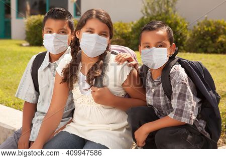Young Hispanic Students on School Campus Wearing Medical Face Masks.