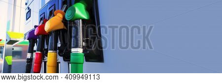 Gas Station For A Car. Column With Fuel Pistols Close-up. Long Banner With Gray Background.
