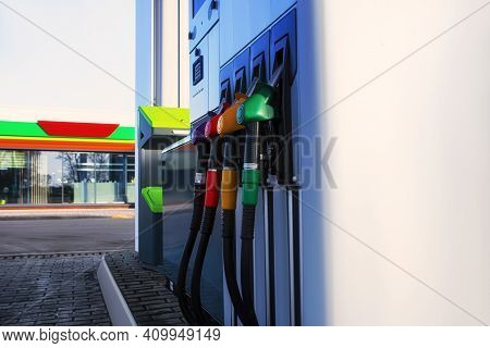 Gas Station With Diesel And Gasoline Fuel Close-up Against The Background Of The Store.