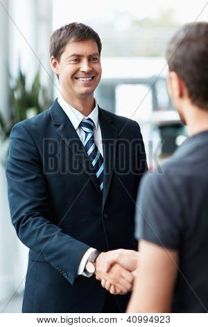 Buyer and seller shake hands
