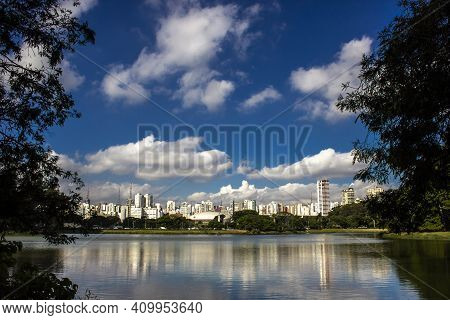 Skyline Reflects On The Tranquil Water Of The Lake In Ibirapuera Park In Sao Paulo City, Brazil