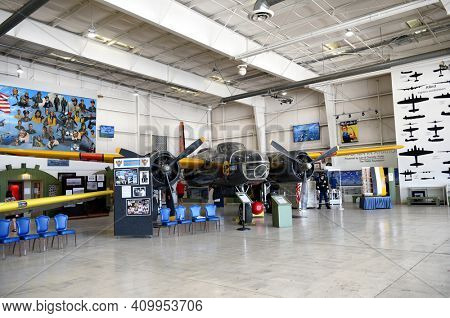 PALM SPRINGS, CA - MARCH 24, 2017: Hangar exhibits with vintage plane at the Palm Springs Air Museum.