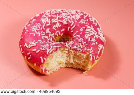 Bitten Tasty Pink Donut On Pink Background