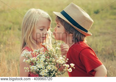 Lovely Children Play. Adventure Children Love Story. Beautiful Little Couple Boy And Girl Kiss. Summ